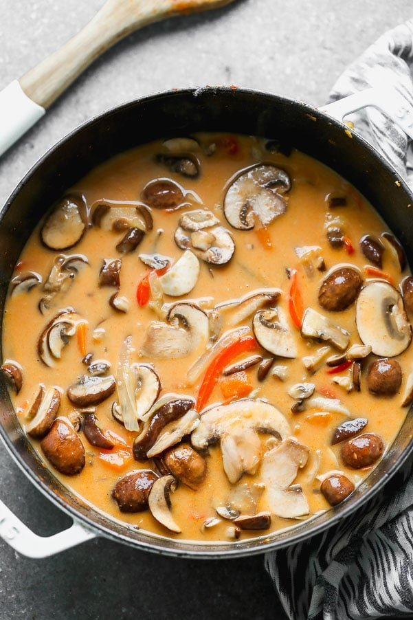 Coconut curry broth with mushrooms, sweet potatoes, and peppers.