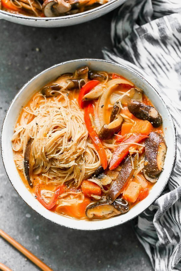 Vegetable Coconut Curry Soup with Rice Noodles is sweet, slightly spicy, and a cinch to throw together. It's packed with tender mushrooms, red bell peppers, onion, and the most delicious coconut curry broth you'll want to drink. It's served with plenty of thin brown rice noodles to slurp!