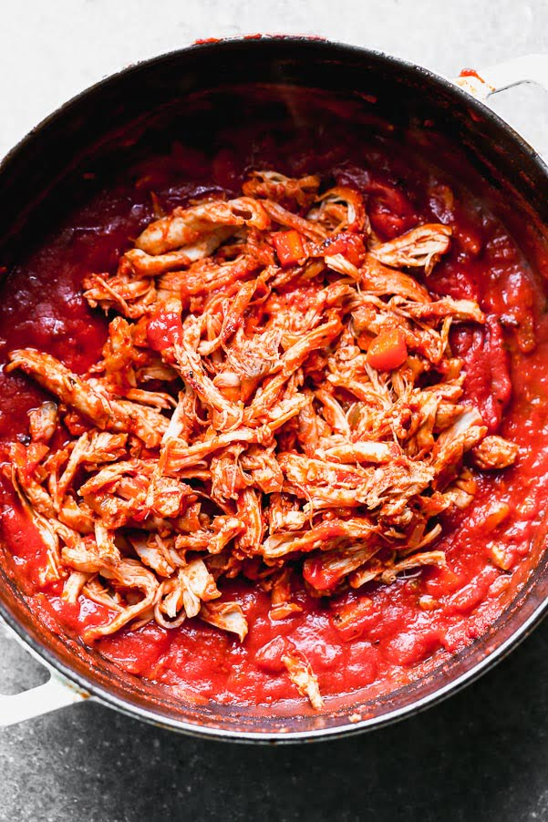 Add shredded chicken back to the sauce.