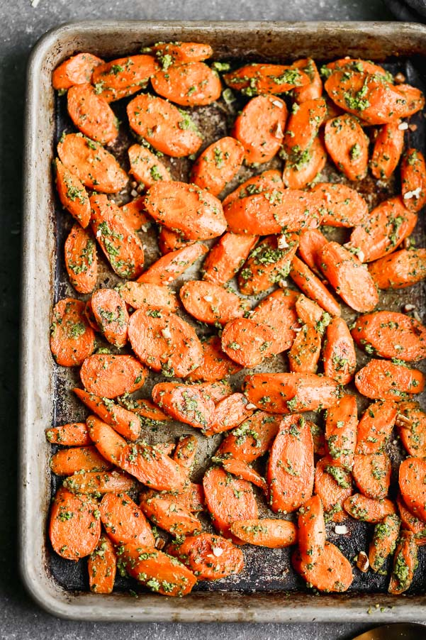 These Easy Roasted Carrots with Pecan Pesto are the perfect side dish for all your spring meals. Fresh spring carrots are roasted until soft and sweet and then tossed in a super easy pecan and spinach pesto. This recipe yields a large amount, so you'll have plenty of leftovers to pull out during the week.