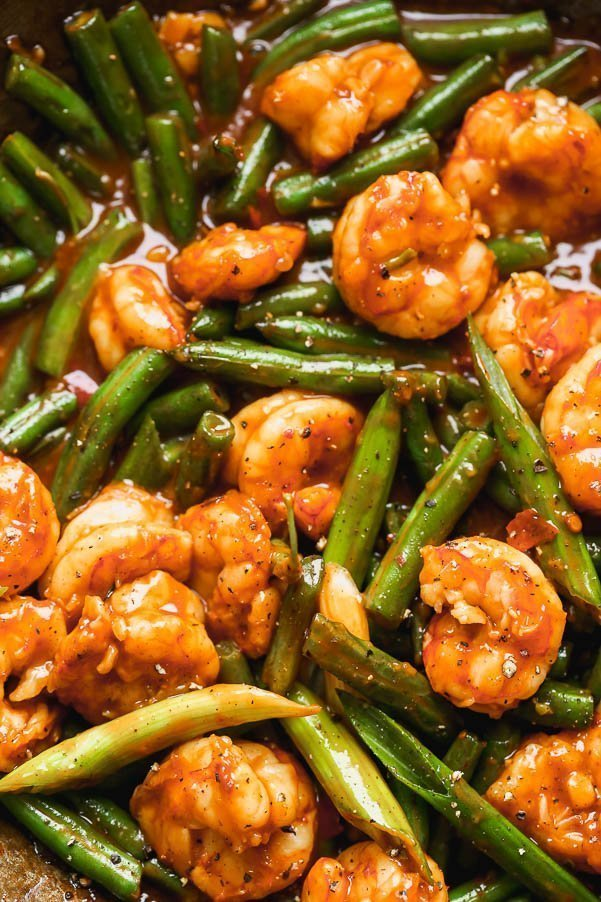 Hunan Shrimp is a hot and spicy shrimp dish packed with flavor from chili bean paste, garlic, soy sauce, and rice vinegar. The spicy plump shrimp are served with blistered green beans and green onions, and served over sticky brown rice. Ready in 20 minutes or less!