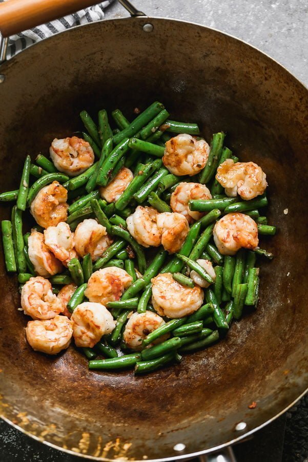Toss green beans and shrimp together