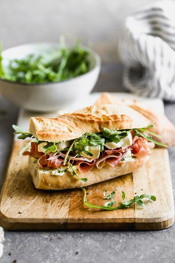 This classic French Baguette Sandwich, also known as a Jambon Beurre Sandwich is such a nice departure from a classic deli sandwich. Our version is layered on a crusty French baguette with salty prosciutto, an easy herbed butter, creamy brie, and peppery arugula. Effortlessly elegant, and most importantly, so delicious.