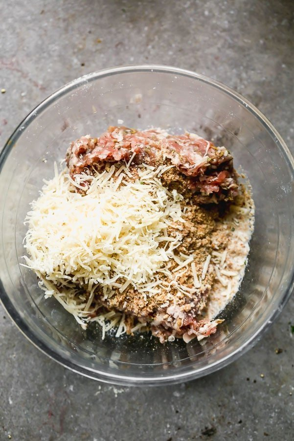 Add Italian sausage, egg, parmesan, salt, breadcrumbs, and milk to a medium bowl.