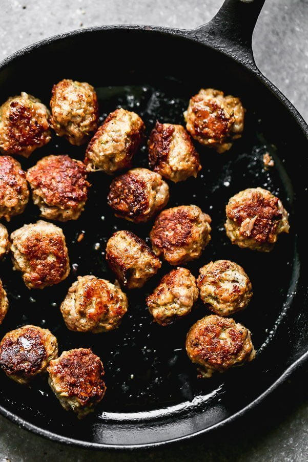 Sear meatballs in olive oil until crust and brown.