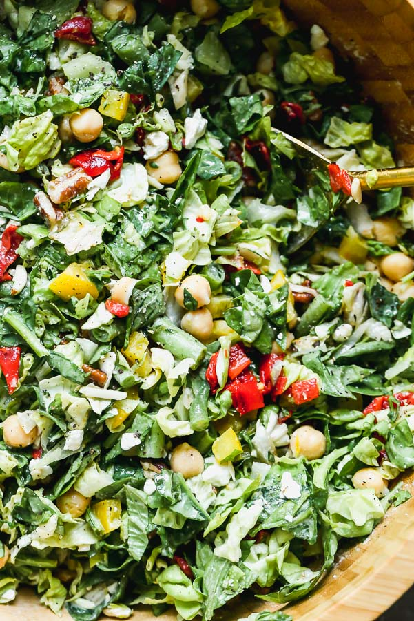 Easy Chopped Salad with tons of veggies, chickpeas, and an easy tahini vinaigrette.