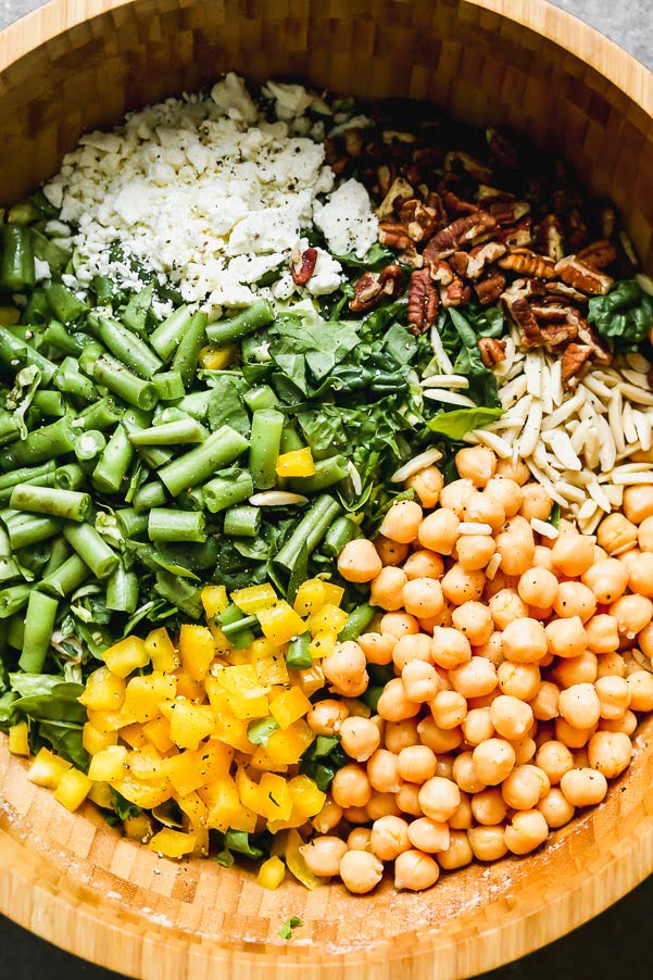 Chopped salad with pecans, feta, green beans, chickpeas, yellow peppers, and almonds