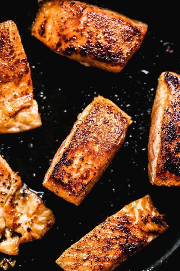 Crispy seared salmon in a cast-iron skillet