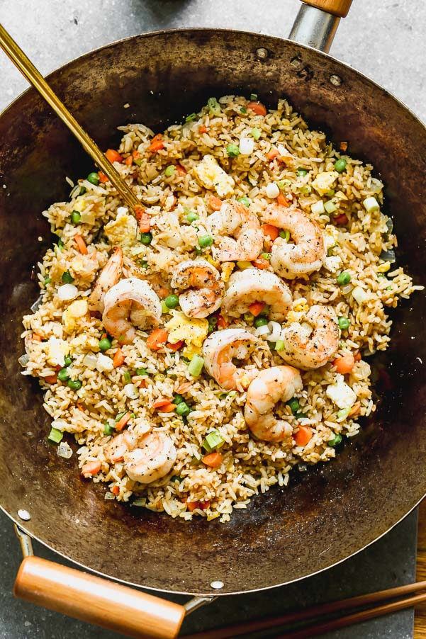 The BEST Shrimp Fried Rice with peas, carrots, and lots of scrambled eggs. Perfect way to use up leftover rice!