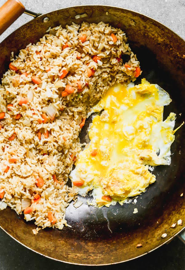 Scramble two eggs with sesame oil
