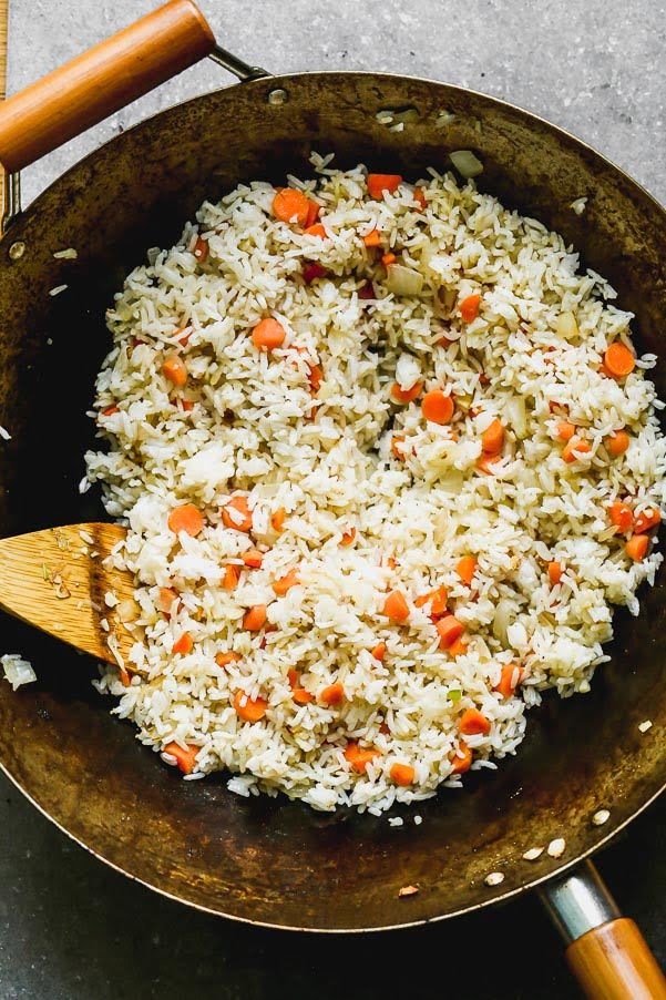 Stir fry carrots and rice with sesame oil