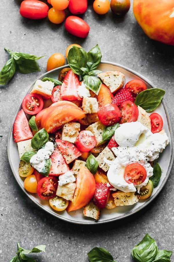 If there were ever a salad that represented summer it would be this Burrata Panzanella. We coat toasted cheesy bread croutons, juicy heirloom tomatoes, and strawberries in an easy honey lemon vinaigrette and then nestle creamy truffle burrata on top along with as much fresh basil as your yeart desires. Garnish with freshly cracked black pepper and flaky pieces of maldon sea salt.