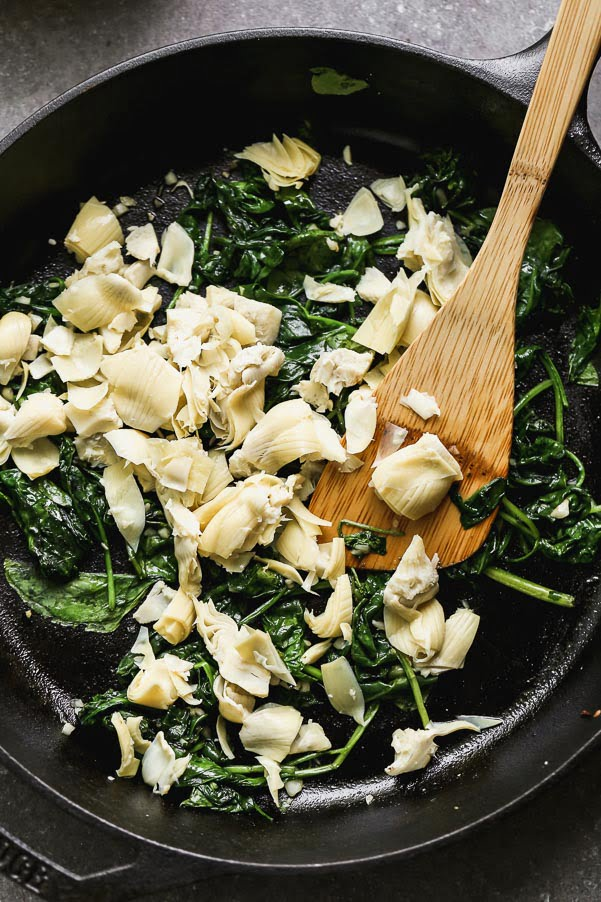 Spinach and artichoke in cast iron skillet