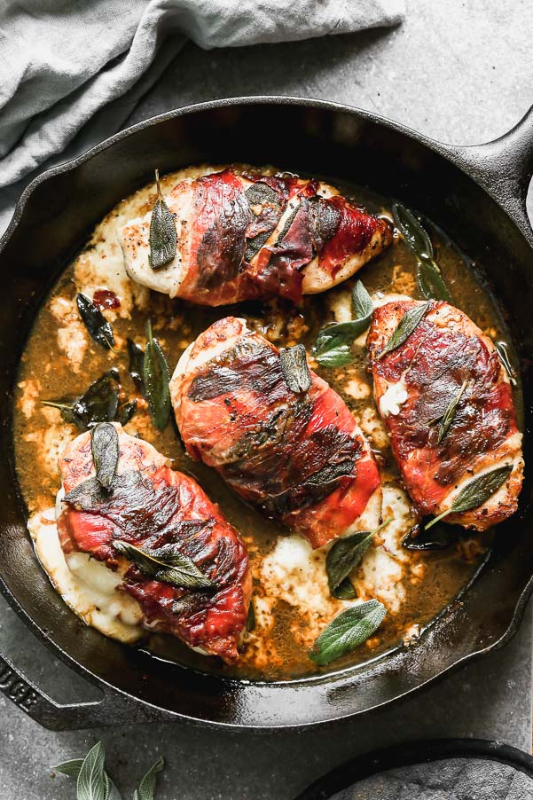 Another day, another chicken dinner. Our Baked Chicken Saltimbocca is a classic, with a twist. We take plump chicken breasts and stuff them with gooey fontina cheese, wrap them in sage and prosciutto, and then sear them in a mixture of butter and olive oil. The cheesy chicken breasts are then cooked in an easy marsala lemon sauce and served with plenty of fresh sage.