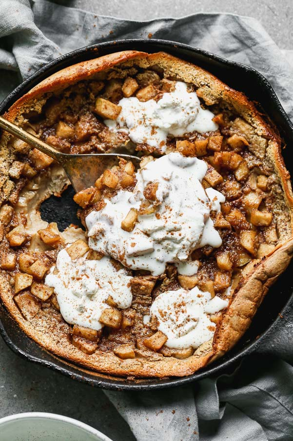 Our Caramel Apple Clafoutis Recipe is one of the easiest most impressive desserts you'll make all fall long. This pancake meets soufflé baked dessert is studded with brown butter caramel apples, plenty of warm fall spices and baked until brown on the outside and soft and custard-like on the inside. Oh, and it's a cinch to throw together.