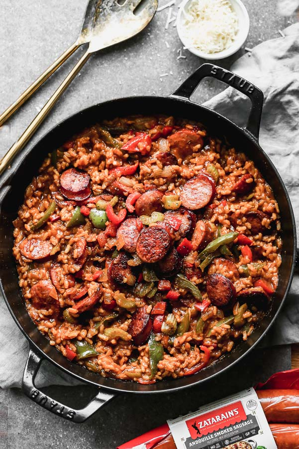 Spicy Cajun food meets creamy cheesy Italian food in our Cheesy Cajun Sausage Risotto. This one-pot wonder has everything you need in a hearty dinner - creamy arborio rice, plenty of veggies, spicy andouille sausage, and a cheese factor you'll fall in love with.