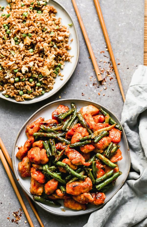 Hunan Chicken is our answer when we're craving super spicy Asian food. We take tender chicken tenders and stir-fry them until crisp, along with green beans and then coat it all in a super easy, fiery, and tangy chili bean sauce. 25 minutes of prep and cook time, virtually fool proof.