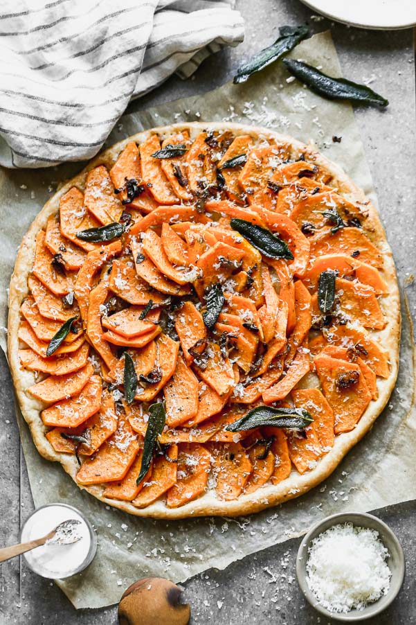 Our Butternut Squash Tart is not only a showstopper visually, but seriously delicious as well. We take sweet butternut squash laced with brown butter and shallots and layer it on crispy puff pastry. We top it off with plenty of parmesan cheese, fried sage leaves, and flaky maldon sea salt.