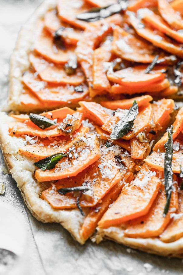 Our Butternut Squash Tart is not only a showstopper visually, but seriously delicious as well. We take sweet butternut squash laced with brown butter and shallots and layer it on crispy puff pastry. We top if off with plenty of parmesan cheese and, fried sage leaves, and flaky maldon sea salt.