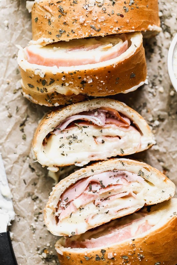 With just five ingredients, you can whip up our favorite easy lunch: Ham and Cheese Stromboli. We take frozen bread or pizza dough, layer it up with salty ham, gooey white American cheese, and then roll it up and bake. Simplicity at its finest, and oh-so cheesy.