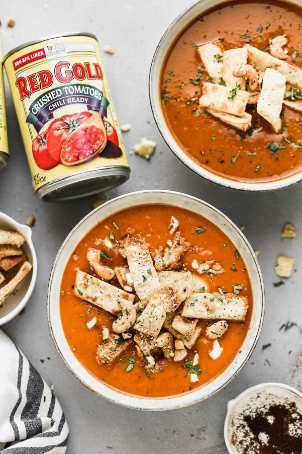 Indian Tomato Soup. We take all the classic flavors of our traditional tomato soup - canned tomatoes, carrots, and plenty of garlic - and blend them with some of our favorite Indian spices for a hybrid tomato soup that will knock your socks off.