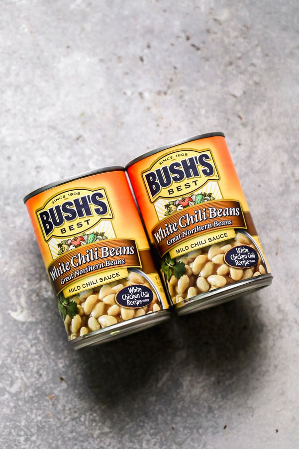 Cans of BUSH'S White Chili Beans.