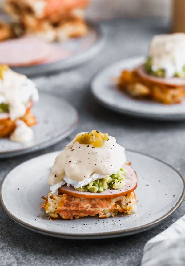 We have put a twist on everyone's favorite brunch item – eggs benedict! Our Green Chile Avocado Eggs Benedict swaps out an English muffin for a cheesy, crispy hash brown waffle base. We top it with citrusy smashed avocado, hickory-smoked Canadian Bacon and a cheesy green chile-infused mornay sauce. Brunch heaven!