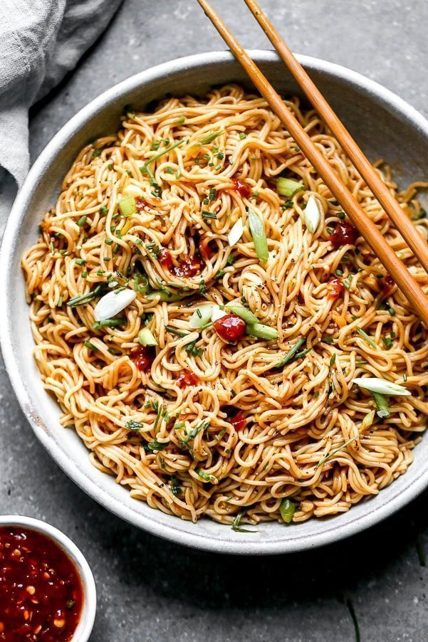 Our Chili Garlic Noodles use only five simple ingredients and bring dinner to your table in 20 minutes or less. We stir-fry brown rice ramen noodles with chili paste, LOTS of garlic, soy sauce, and plenty of scallions. What results is a simple Asian noodle packed with spice and flavor.