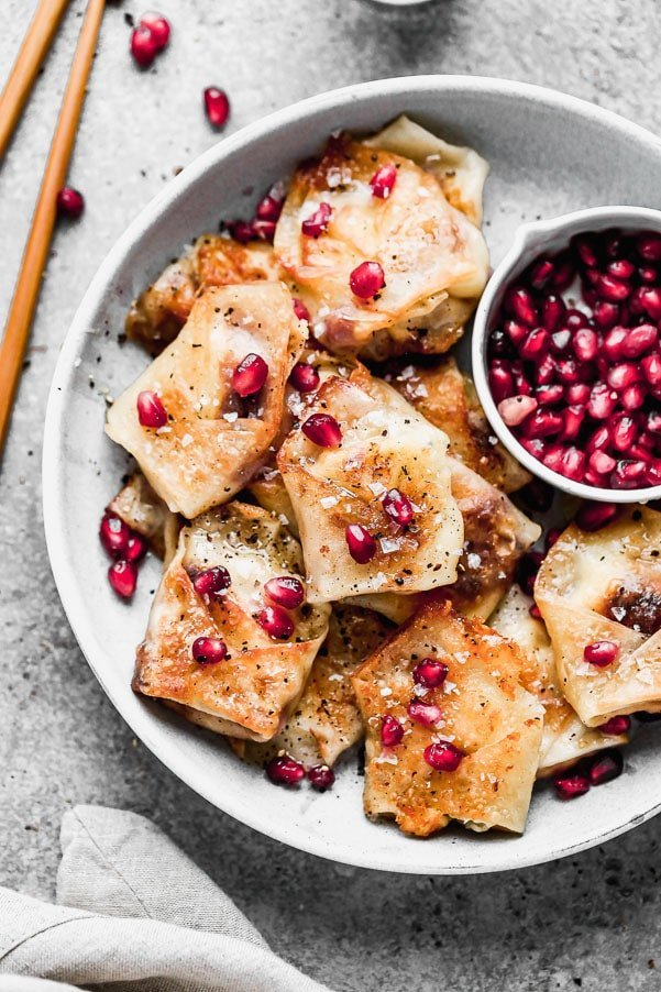 Crispy Pomegranate and Brie Potstickers! This fun twist on a classic is perfect for entertaining and only five ingredients!