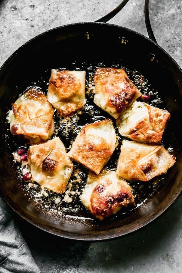 Brown potstickers in canola or olive oil