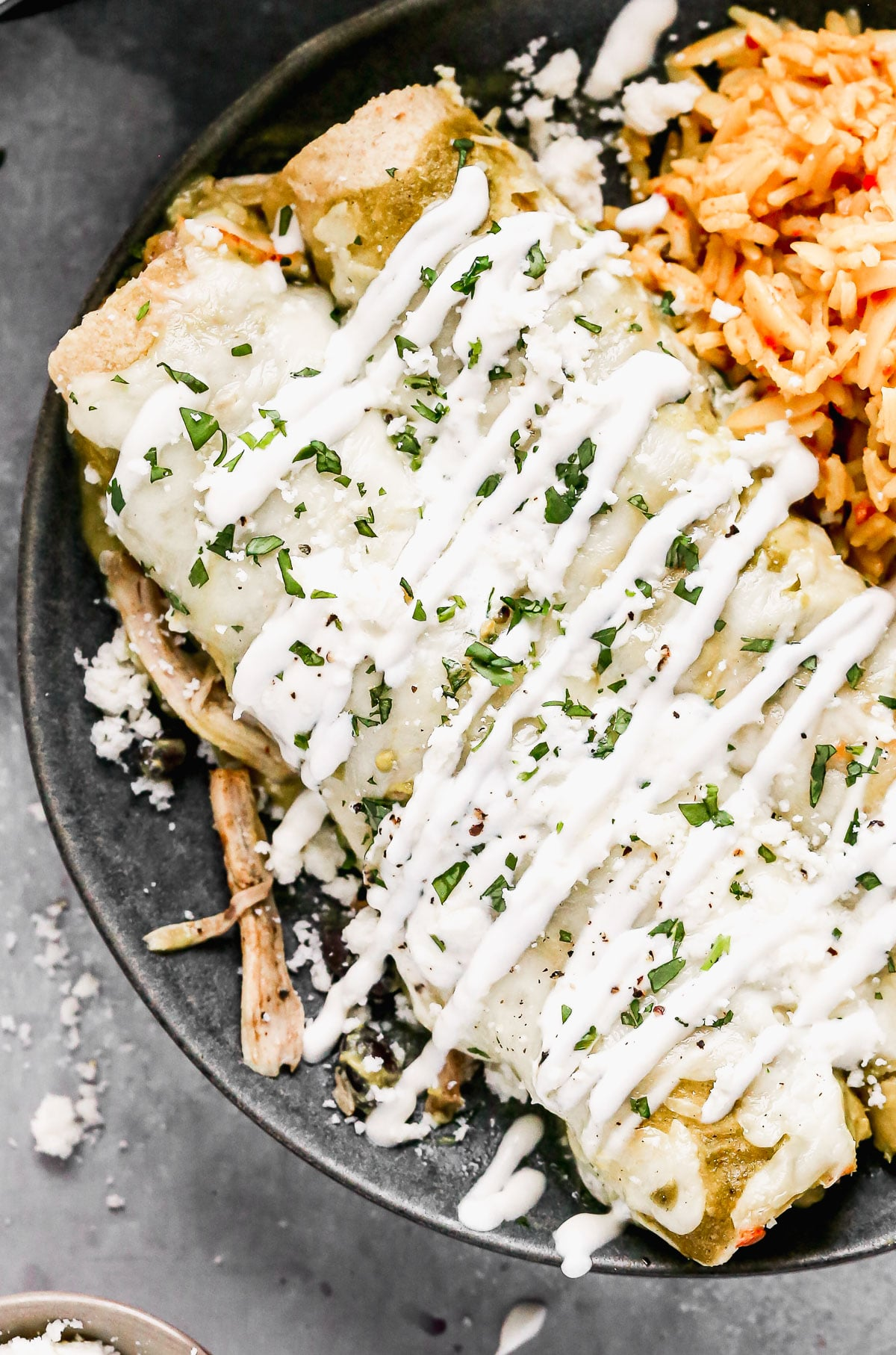 Bathed in homemade roasted salsa verde, stuffed with smoky shredded chicken and black beans, and smothered in melty monterrey jack cheese, these Enchiladas Verdes really hit the tex-mex spot. By roasting everything on one pan, these made-from-scratch enchiladas come together with a little bit less effort than your average homemade enchilada recipe. And do I even need to address how delicious they are?? So so good.