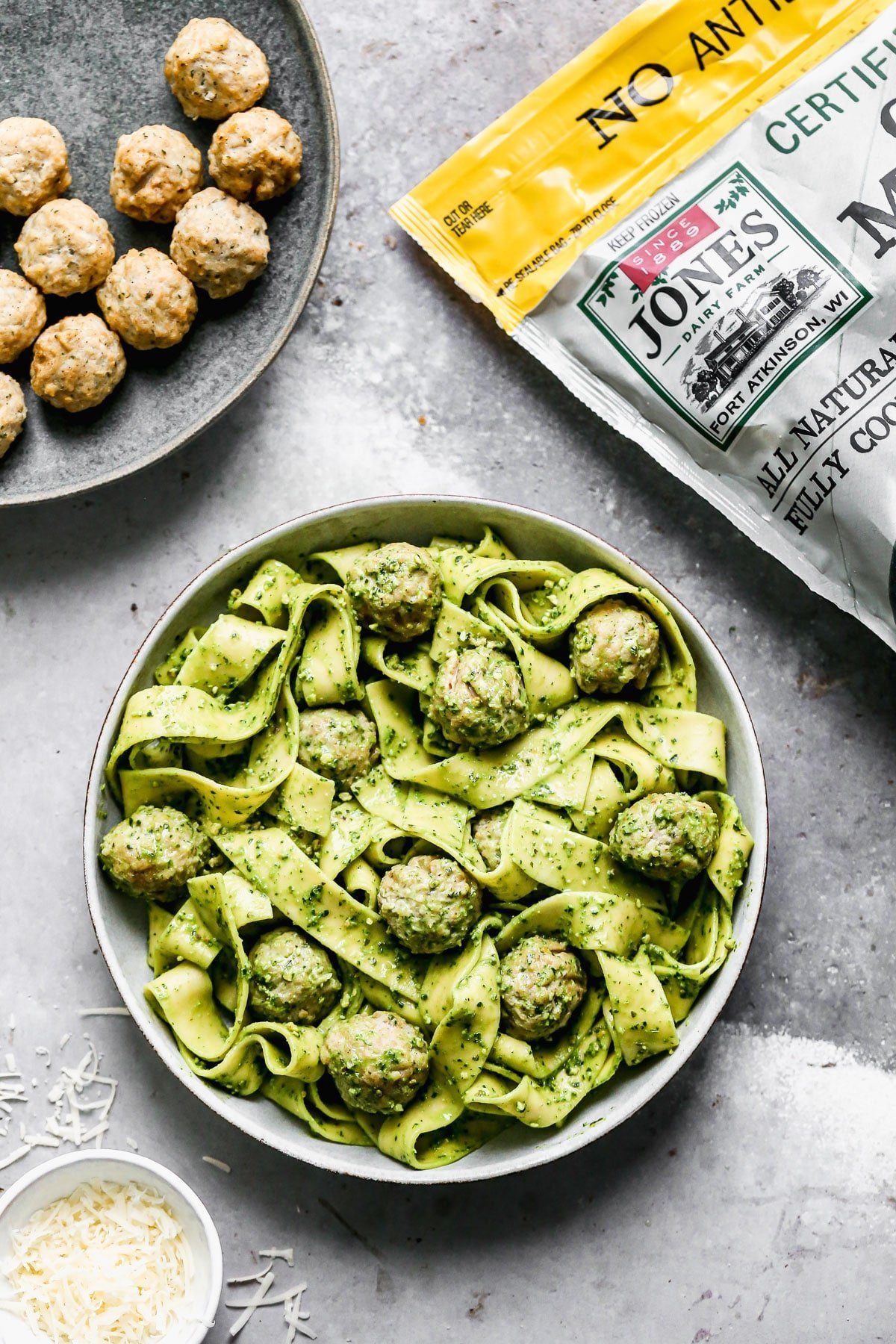 Twirly noodles tossed in a five-minute kale pesto, tender chicken meatballs, and plenty of nutty parmesan are the makings of our new favorite throw-it-together weeknight meal – Kale Pesto Pasta. Just because it's winter, doesn't mean we have to leave homemade pesto behind. Swapping out hearty wintery kale for a portion of the pesto brings a little seasonal aspect to our pesto and using crunchy almonds instead of pine nuts make this easy meal pocket-friendly as well.