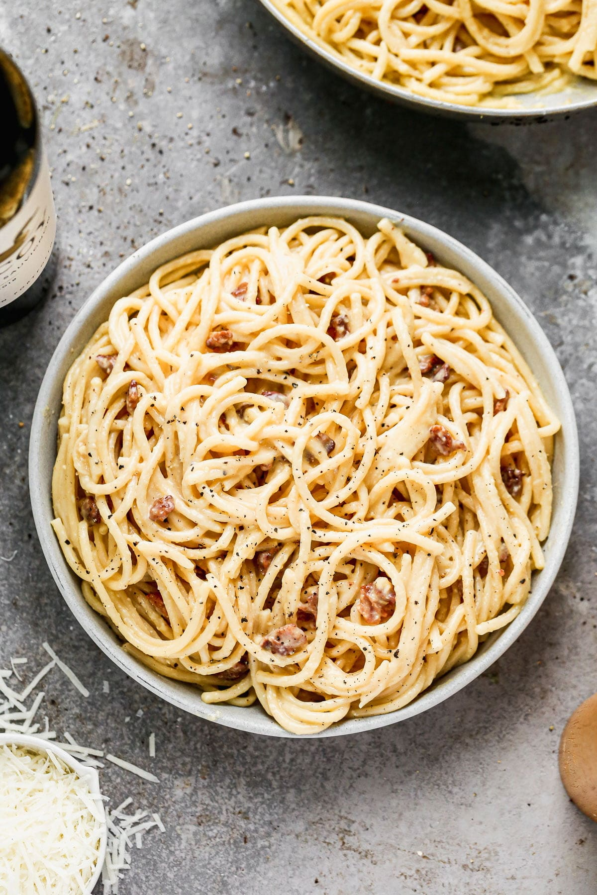 Silky-smooth noodles twirled in a rich, creamy (but cream-less) sauce, nutty pecorino cheese, and bits of salty bacon, our Bucatini Carbonara is the ultimate in Italian comfort food and arguably, the simplest. Our version amps up the amount of both cheese and bacon, adds in a little bit of garlic, and swaps out classic spaghetti for thick bucatini noodles.