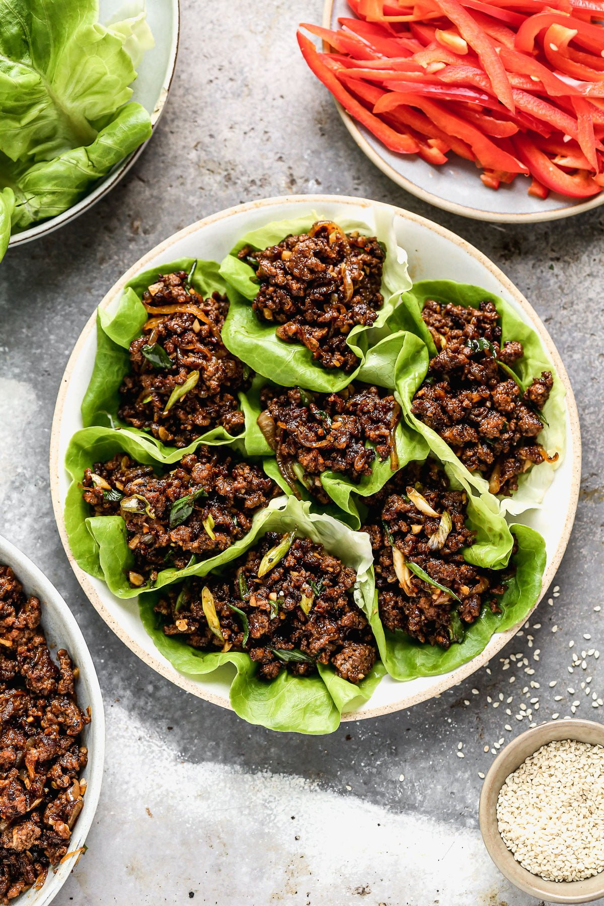 Ultra crispy and smothered in a soy-based sauce studded with rich brown sugar, sweet mirin wine, and brimming with heat from Sambal Oelek, these Beef Lettuce Wraps are my new favorite way to do lettuce. With easy-to-find ingredients, and minimal prep and cook time, they're also the perfect way to get dinner on the table without  much effort.