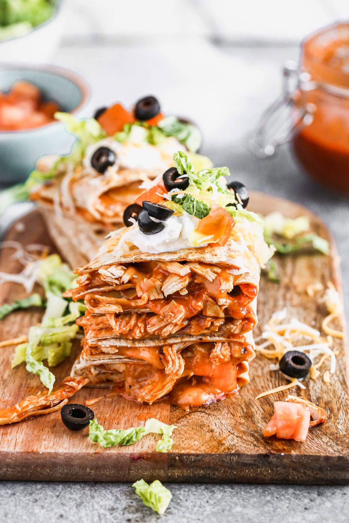 Chickenenchilada on the inside, taco on the outside is what makes ourChicken Enchilada Taco Quesadillastheperfecthandheld hybrid of three classic tex-mex dishes. Each whole-wheat tortilla is filled with saucy shredded chicken (made with our epic homemade enchilada sauce) and cheese, pan-fried and then smothered with all your favorite taco fixings!