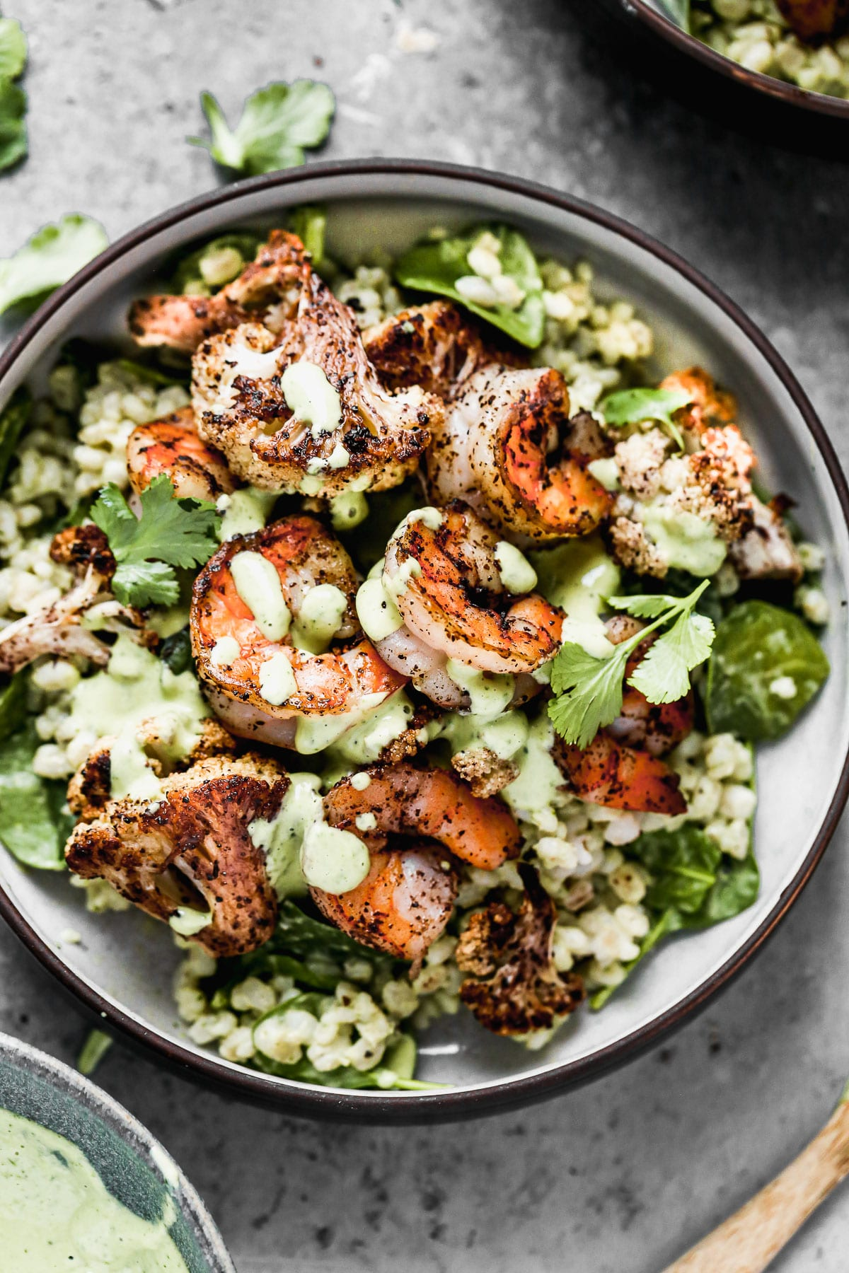 Nutty barley tossed in a zippy green tahini sauce, lemony sumac-roasted cauliflower and shrimp, and pops of crunchy pine nuts are the makings of our Green Tahini Shrimp Bowls - our new favorite way to do healthy. Make everything and serve the day of or pack it up and keep in the fridge to serve thought the week.