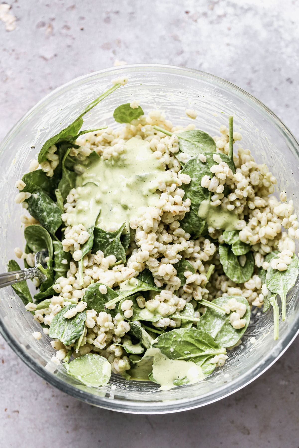 Barley tossed with green tahini and spinach