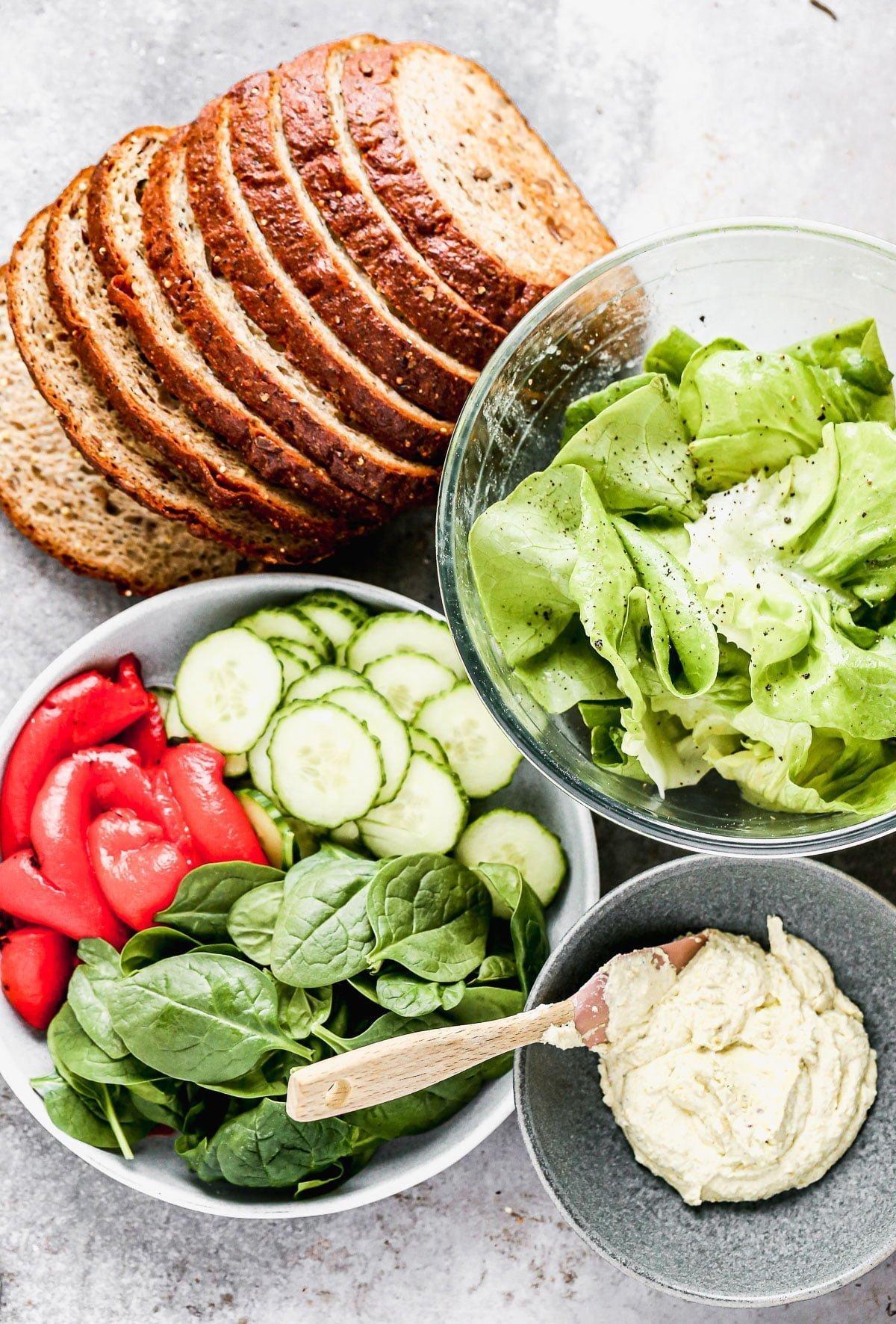 Multi-grain bread, butter, lettuce, and pistachio goat cheese.
