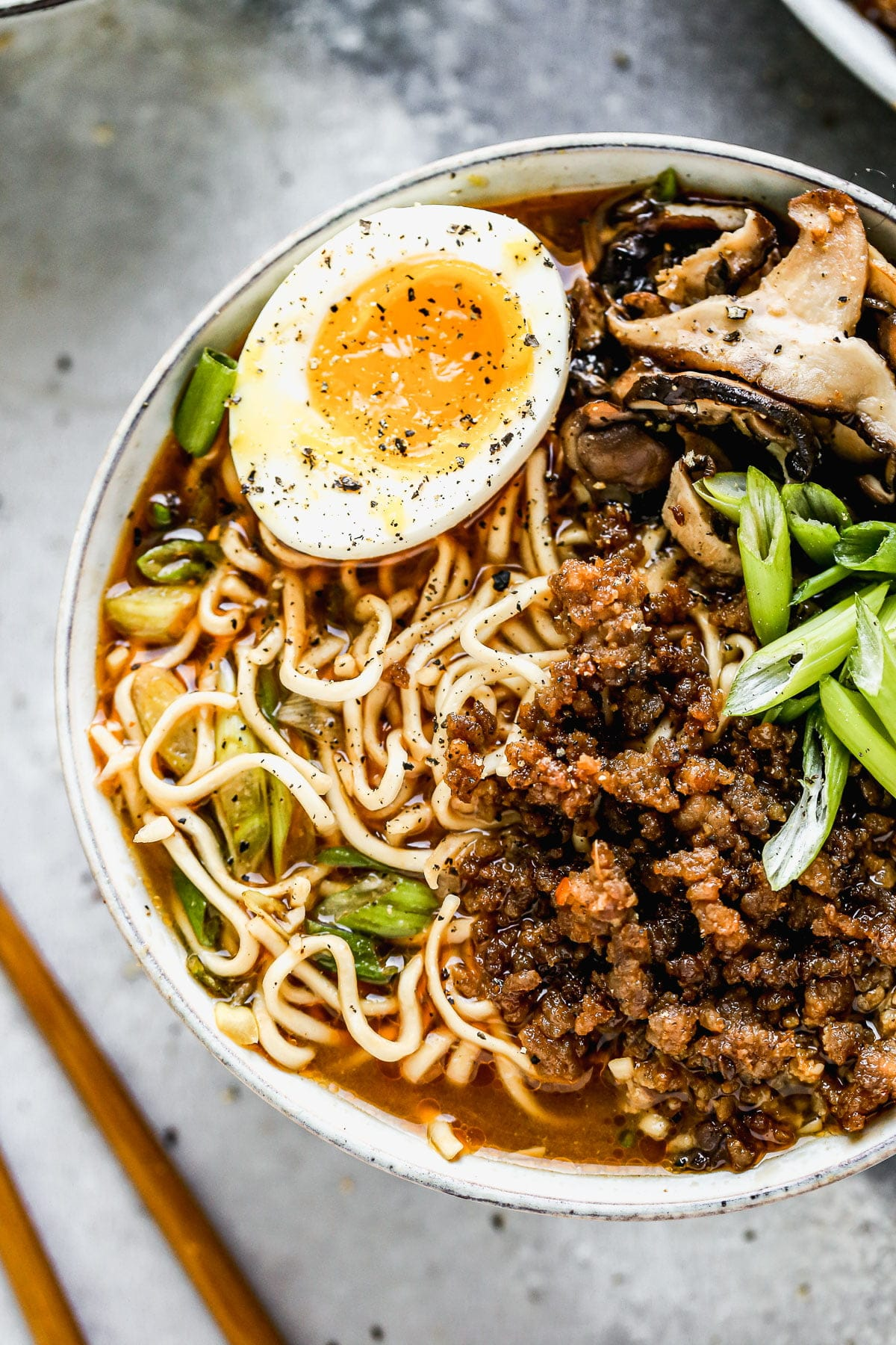 These semi-homemade Pork Miso Ramen Bowls are packed with a spicy miso broth, crispy hoisin pork, quick-pickled mushrooms, a jammy egg (of course), and chewy ramen noodles. They're highly addictive, perfect for busy days, and the only thing I want to eat from now until spring. Find the full recipe with the direct link in our profile.