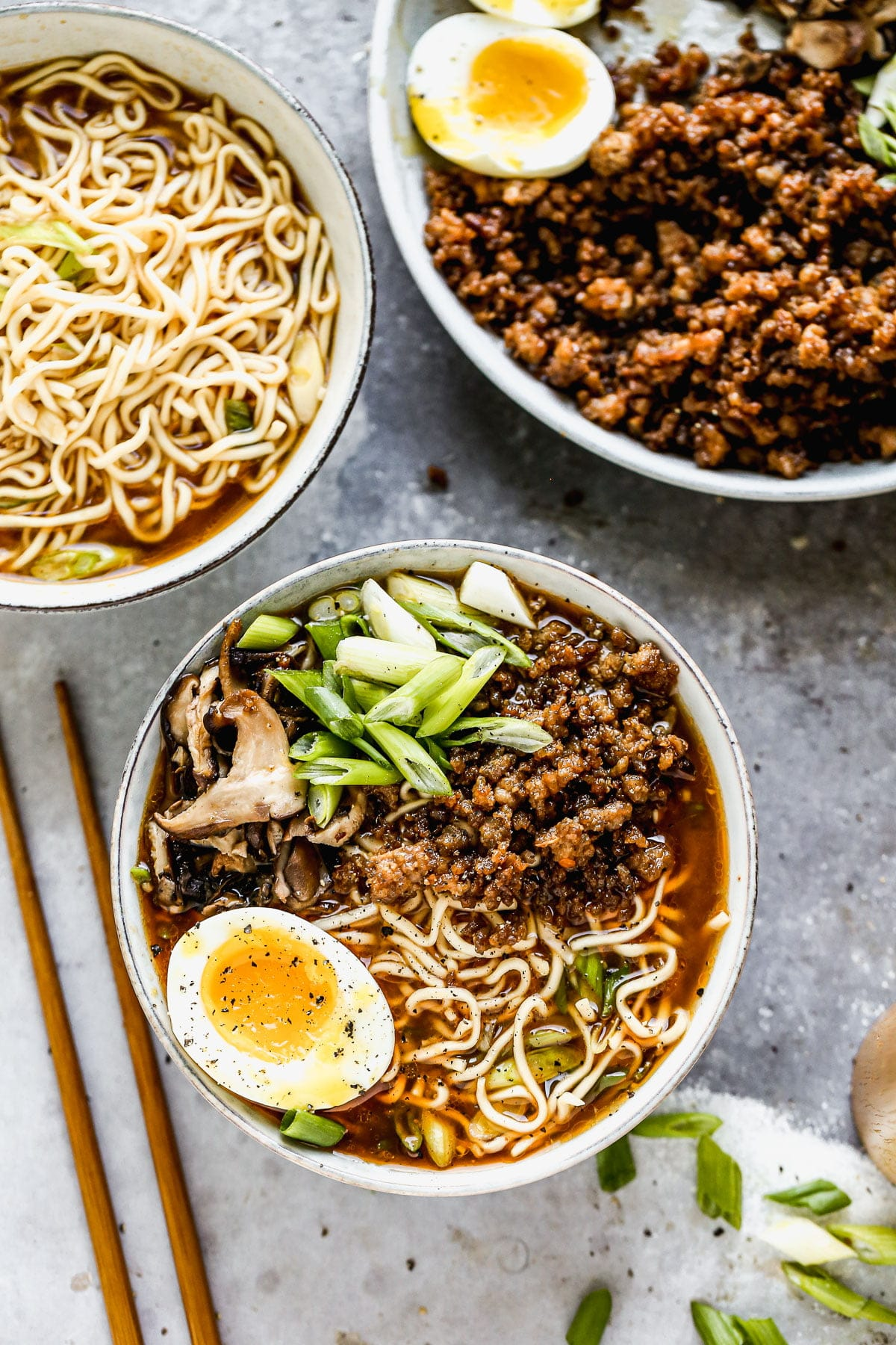 Let's eat ramen that looks like it came from the trendiest of restaurants, tastes like it was cooked all day long, and makes you feel as if you just received the warmest, coziest hug on the planet. But let's make it in 25 minutes, at home, and with just a little bit of help from @Maruchan_Inc. These semi-homemade Pork Miso Ramen Bowls are packed with a spicy miso broth, crispy hoisin pork, quick-pickled mushrooms, a jammy egg (of course), and chewy ramen noodles. They're highly addictive, perfect for busy days, and the only thing I want to eat from now until spring.