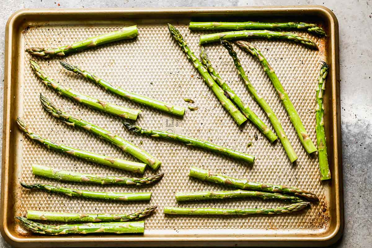 Spread asparagus out on a sheet pan