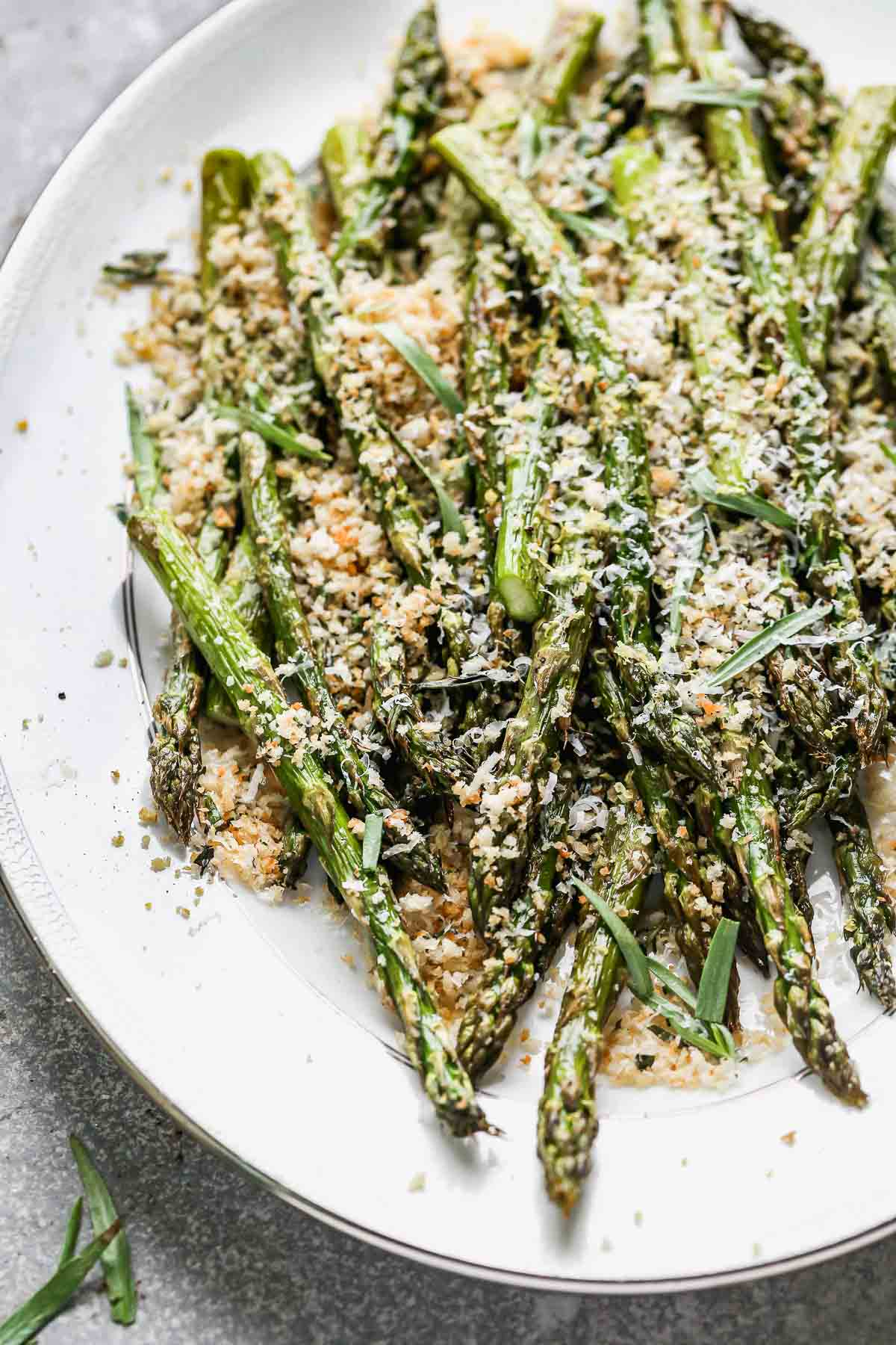 Tender and crispy on the outside with a slight bite on the inside, and covered in cheesy garlicky breadcrumbs (with hints of lemon!), our Easy Roasted Asparagus with Breadcrumbs is the perfect way to up your roasted veggie game this spring. Make a double or triple batch to feed a crowd, or scale it back to feed a family of four.