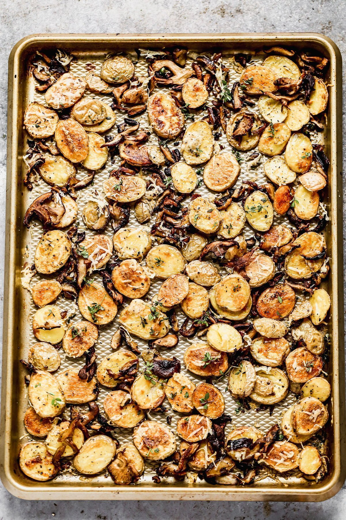 Crispy Parmesan Roasted Potatoes and Mushrooms, always. We roast buttery yukon gold potatoes and woodsy shiitake mushrooms until they're irresistibly crispy and golden, then toss them with nutty parmesan cheese and fresh thyme. Simple, but so delicious.