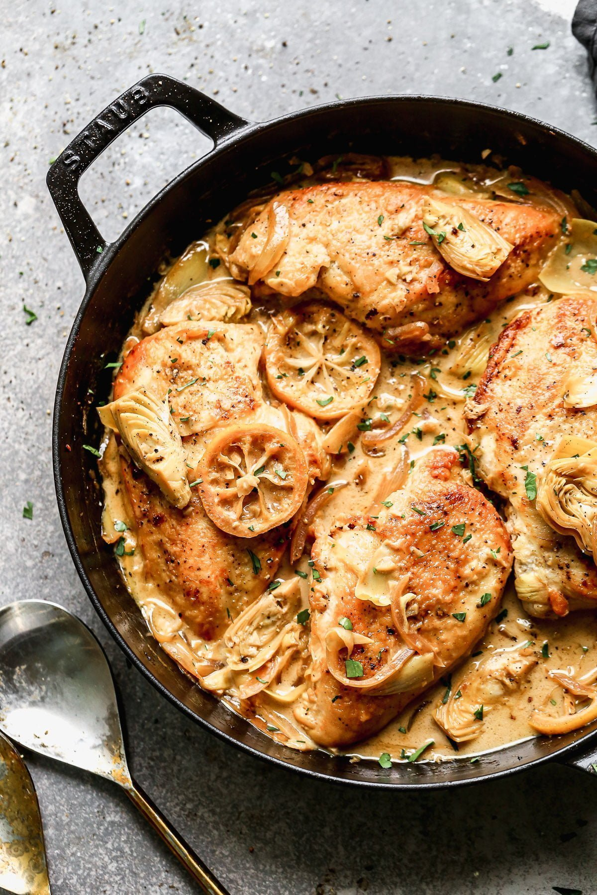 Swimming in a luscious lemon-infused wine sauce and studded with briny artichokes and sweet caramelized onions, our Chicken with Artichokes is the perfect bright springy dish to whip up when we also need a little cozy for those curve ball cold days we all get this time of year.