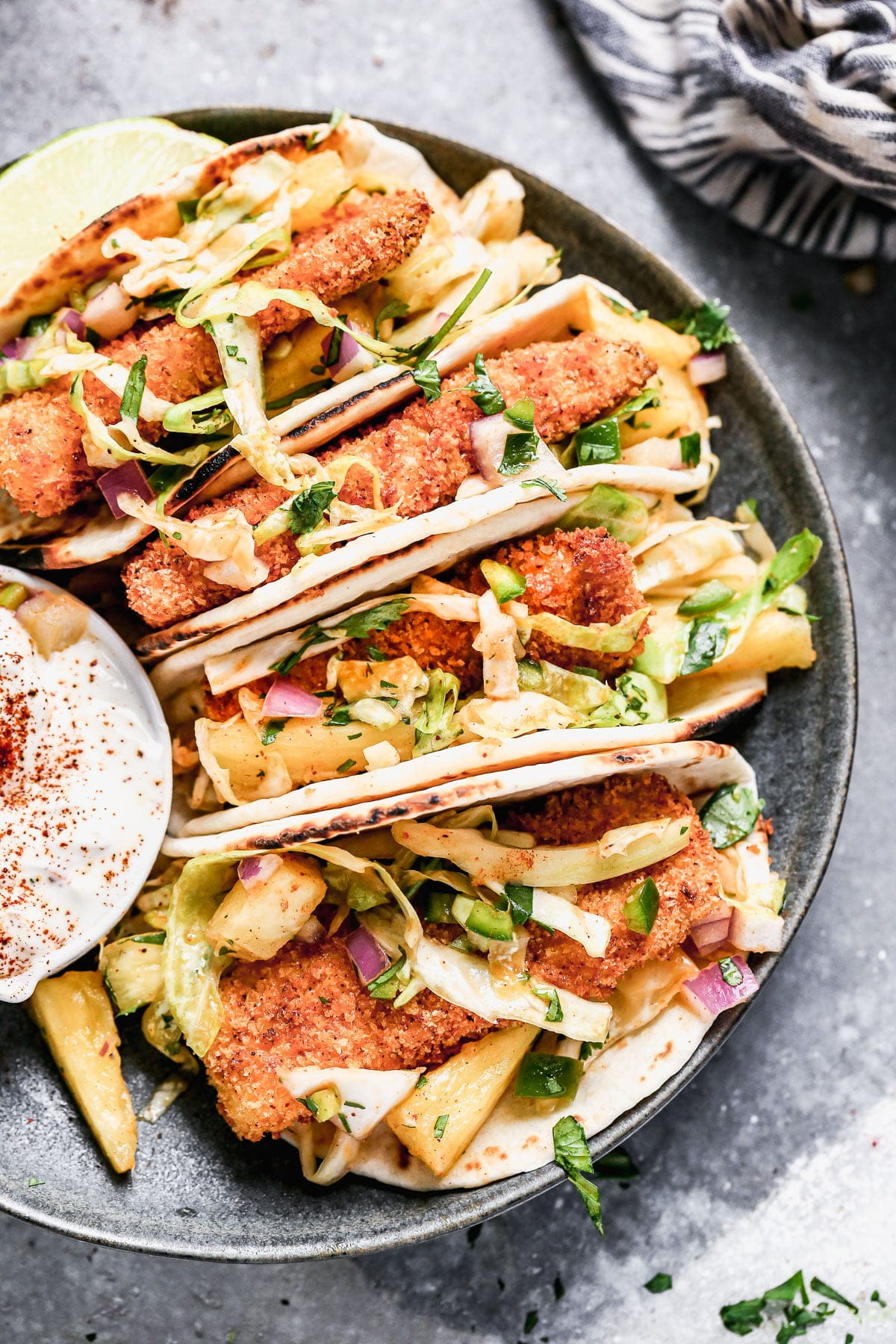 Ultra crispy breaded fish filets nestled into charred flour tortillas and topped with a sweet and spicy pineapple slaw, our Air Fryer Tacos are sure to be your new favorite taco.