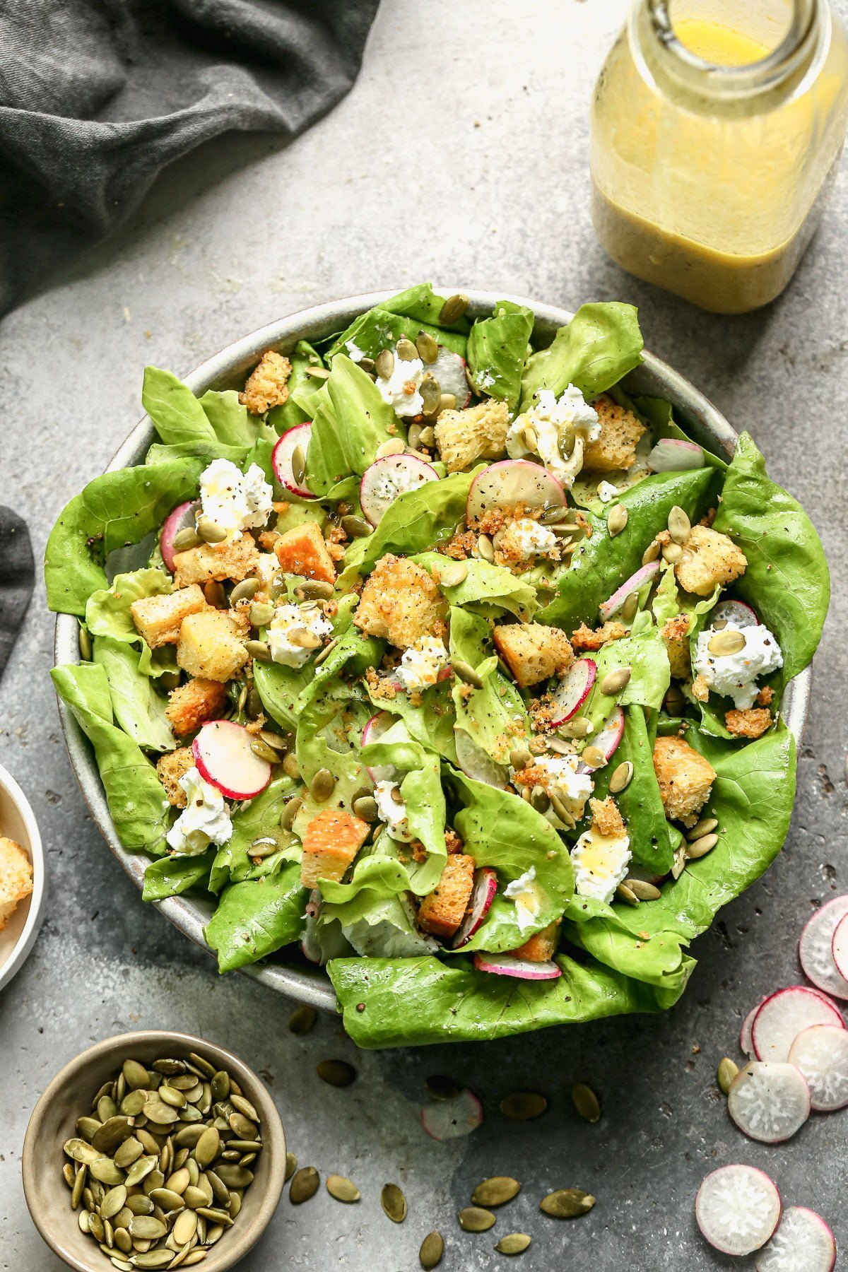 Summer is upon us and so are light, refreshing, seasonal salads. Brimming with homemade croutons, creamy goat cheese, crunchy pepita seeds, and crisp radish, our Butter Lettuce Salad is an easy side dish we come back to time and time again. Prep the dressing and croutons at the beginning of the week and enjoy a little bit every day.