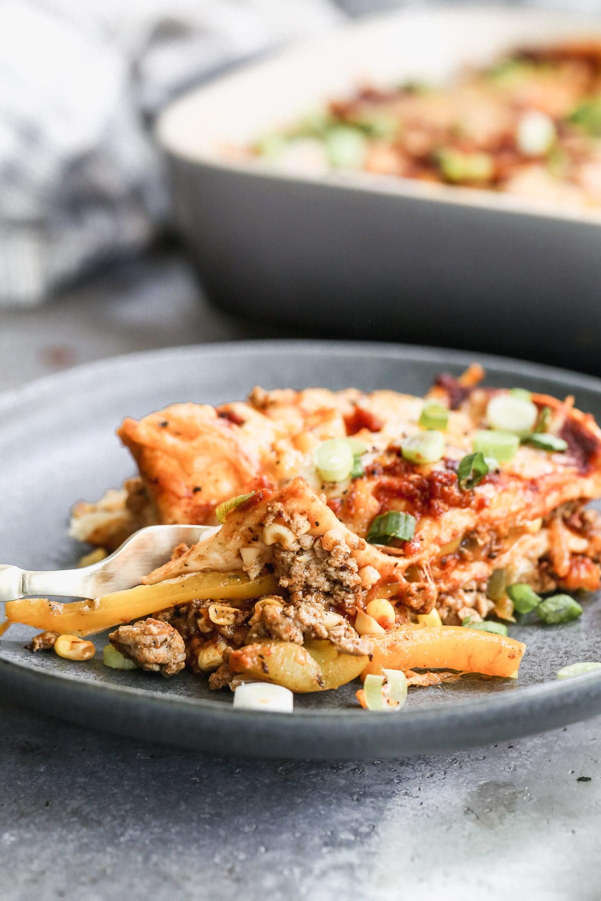Packed with ground chicken or turkey, plenty of veggies, and an easy homemade enchilada sauce, our Chicken Enchilada Casserole is the perfect way to get your enchilada fix in an easier form. Make a day in advance and pop in the oven when you're ready to eat.