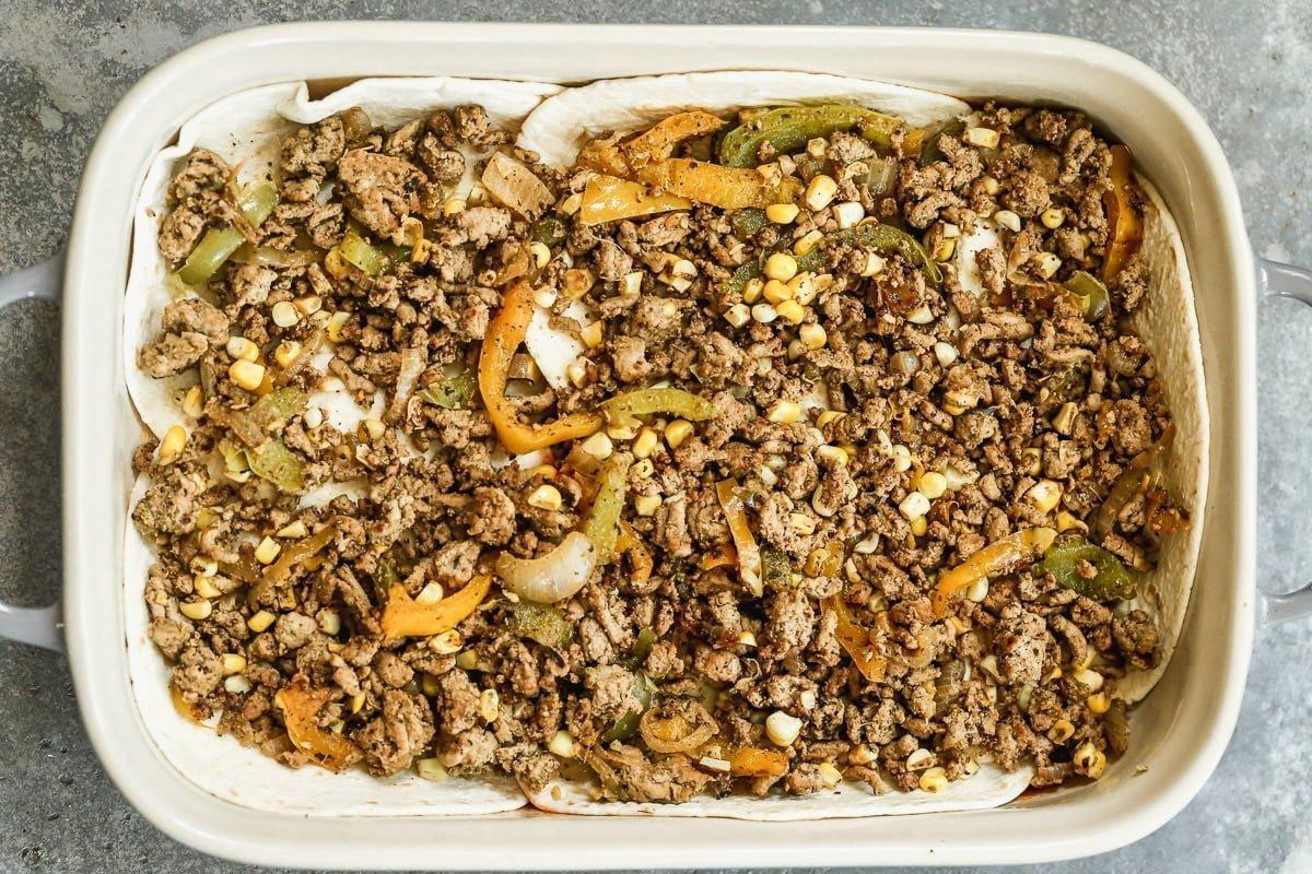 Layer ground chicken and veggies over tortillas