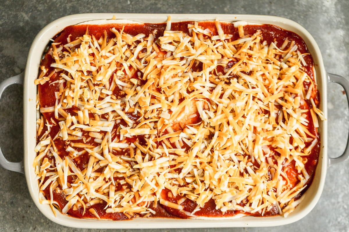 Cover with enchilada sauce and cheese