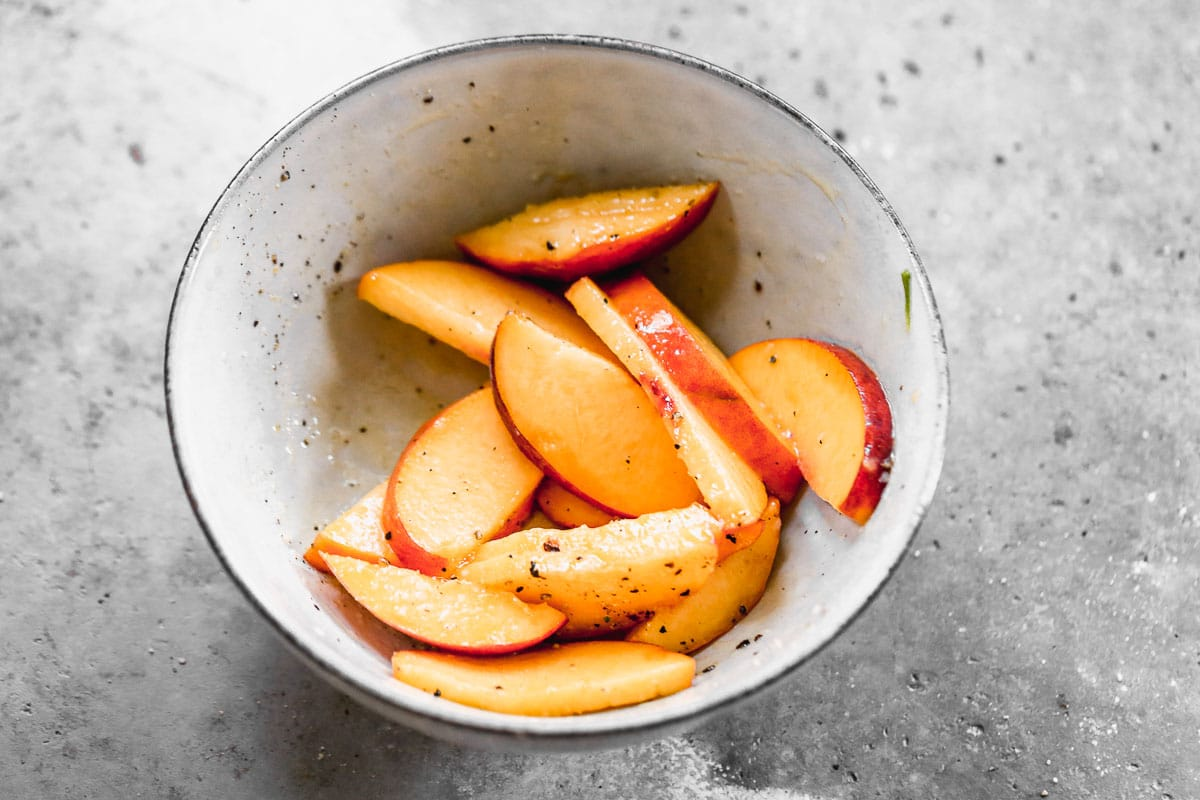 Slice peaches and sprinkle with salt and pepper
